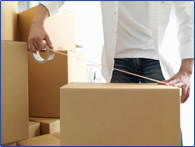 man packing boxes for self storage facility